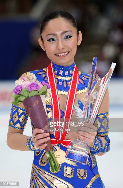 Winner Miki Ando of Japan poses for photographs after competing in the Ladies Free Skating on the day one of ISU Grand Prix of Figure Skating NHK...