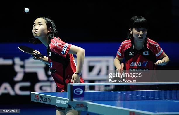 Winner Miu Hirano and Mima Ito of Japan in action during the Women's Doubles final match of the 2014 ITTF World Tour Grand Finals at Huamark Indoor...