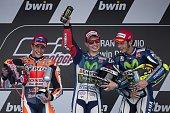 Winner Movistar Yamaha MotoGP's Spanish rider Jorge Lorenzo second Repsol Honda Team's Spanish rider Marc Marquez and third Movistar Yamaha MotoGP's...