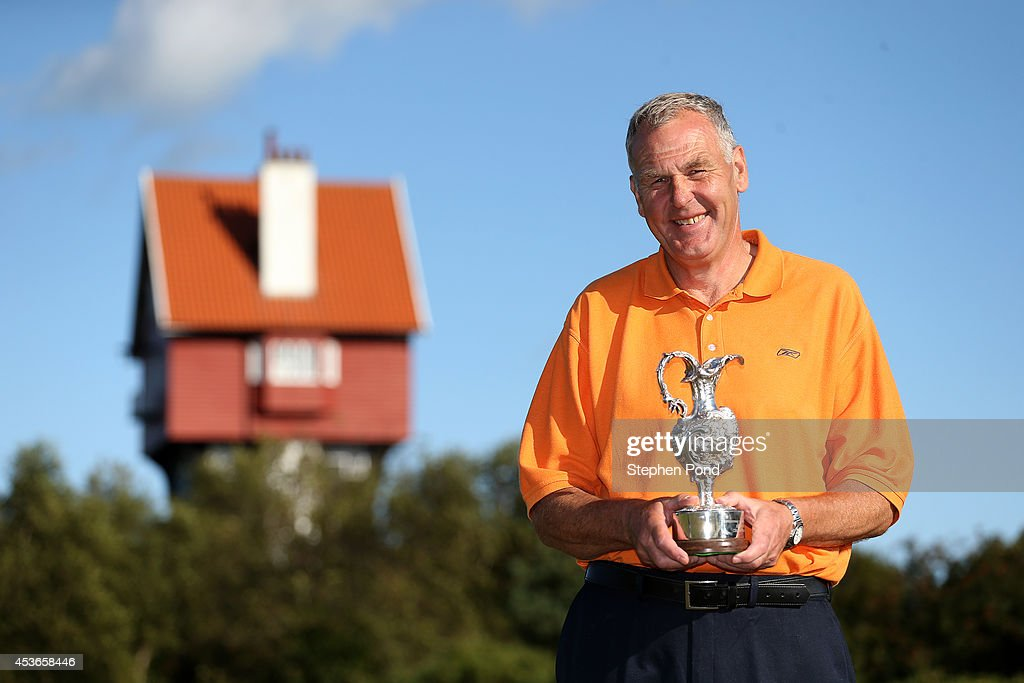 Winner Murray White poses with the trophy after day two of the PGA Super 60's Tournament at Thorpeness Hotel and Golf Club on August 15, 2014 in Thorpeness, England.