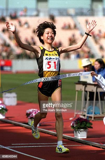 Winner Naoko Takahashi of Japan celebrates as she crosses the finish tape to win the 21st Nagoya International Women's Marathon at Mizuho Stadium on...