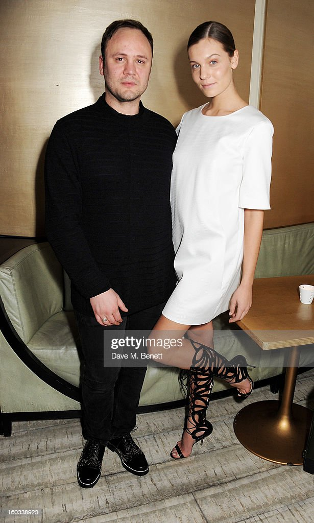 Winner Nicholas Kirkwood (L) and a model wearing his shoe designs attend the BFC/Vogue Designer Fashion Fund winners announcement at Nobu Berkeley on January 29, 2013 in London, England.
