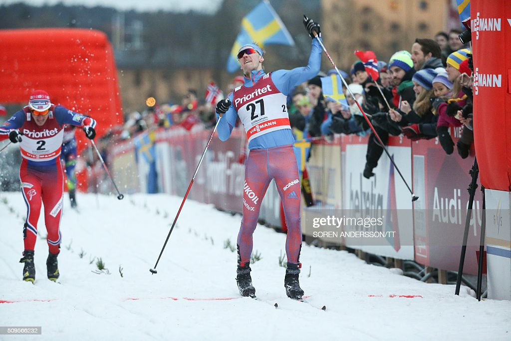 Winner Nikita Krukov, (C) of Russia reacts ahead of second placed Ola Vigen Hattestad (L) during the men's World Cup classic Royal Palace sprint in central Stockholm on February 11, 2016 / AFP / TT News Agency / Soren Andersson/TT / Sweden OUT