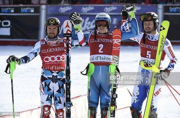 Winner Norway's Henrik Kristoffersen second placed Austria's Marcel Hirscher and third placed Russia's Alexander Khoroshilov celebrate after the FIS...