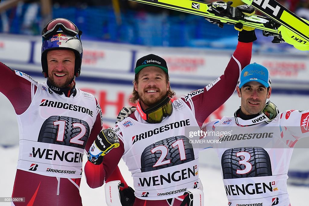 Winner Norway's Kjetil Jansrud secondplaced Norway's Aksel Lund Svindal and thirdplaced France's Adrien Theaux celebrate in the finish area of the...