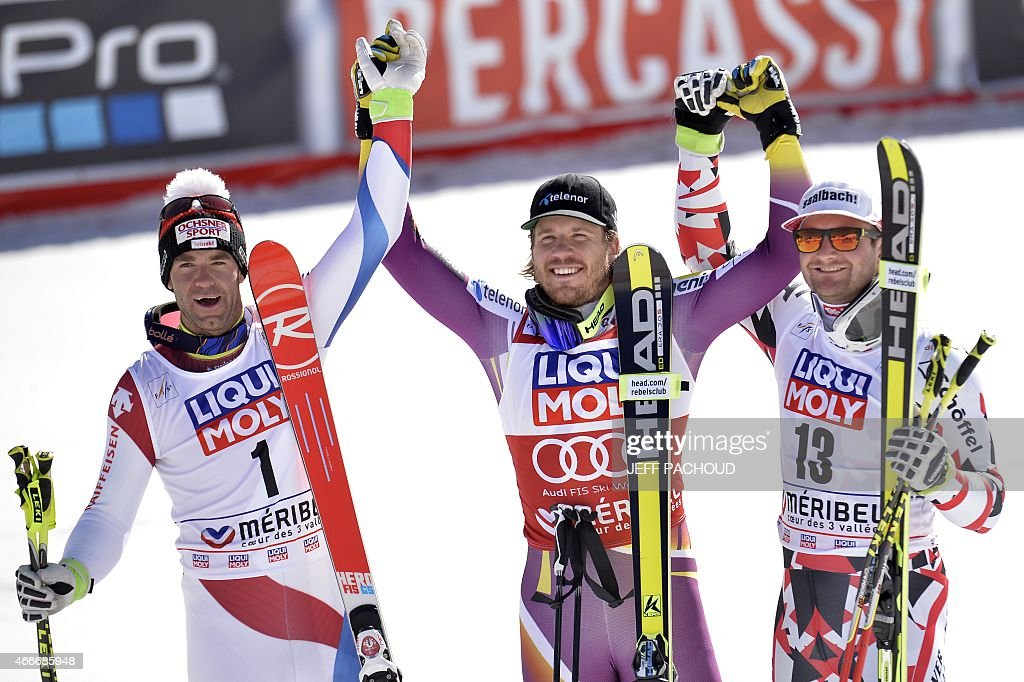 Winner Norway's Kjetil Jansrud secondplaced Switzerland's Didier Defago and thirdplaced Austria's Georg Streitberger pose after the Men's downhill at...
