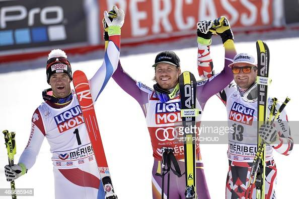 Winner Norway's Kjetil Jansrud secondplaced Switzerland's Didier Defago and thirdplaced Austria's Georg Streitberger pose after the Men's downhill at...