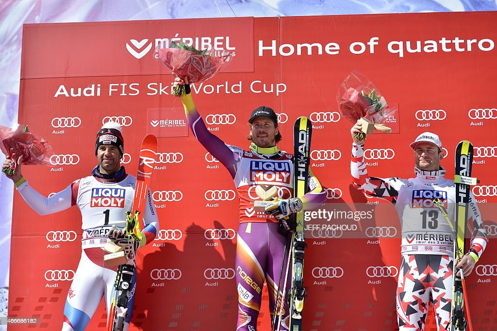 Winner Norway's Kjetil Jansrud secondplaced Switzerland's Didier Defago and thirdplaced Austria's Georg Streitberger pose on the podium of the Men's...