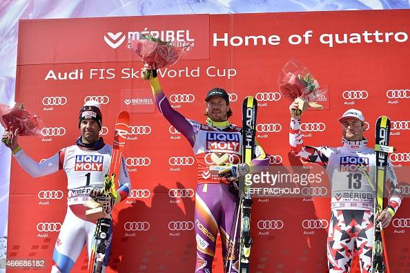 Winner Norway's Kjetil Jansrud secondplaced Switzerland's Didier Defago and thirdplaced Austria's Georg Streitberger pose on the podium of the Men's...
