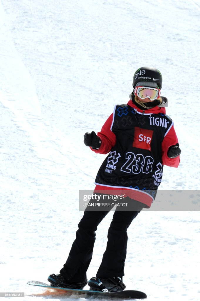 Winner Norway's Silje Norendal arrives in the finish line during the Women's Snowboard Slopestyle final of the European Winter X-Games on March 22, 2013 in the ski resort of Tignes. AFP PHOTO / Jean Pierre Clatot