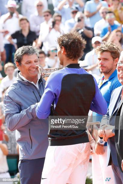 Winner of 10 Roland Garros and of the 2017 edition Rafael Nadal stands his Uncle and Trainer Toni Nadal and Finalist Stan Wawrinka after the Men...