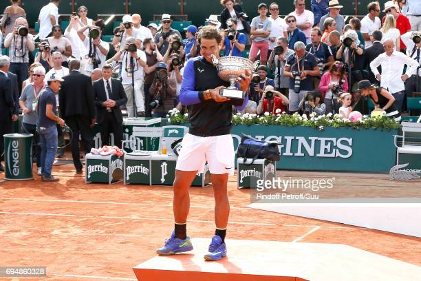 Winner of 10 Roland Garros and of the 2017 edition Rafael Nadal poses with his cup after the Men Final of the 2017 French Tennis Open Day Fithteen at...