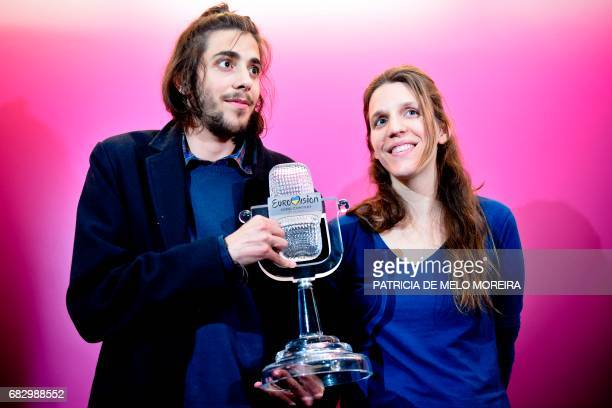 Winner of 2017 Eurovision contest Salvador Sobral accompanied by his sister Luisa Sobral pose with his trophy before a press conference upon their...