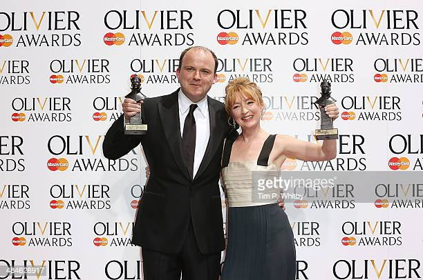 Winner of Best Actor award Rory Kinnear and winner of Best Actress award Lesley Manville pose in the press room at the Laurence Olivier Awards at The...