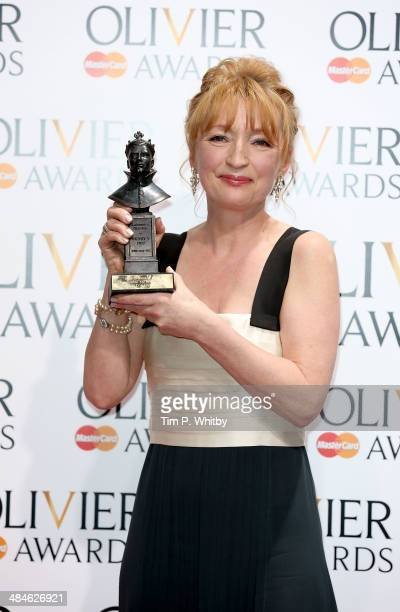 Winner of Best Actress award Lesley Manville poses in the press room at the Laurence Olivier Awards at The Royal Opera House on April 13 2014 in...