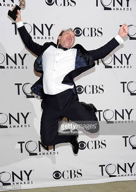 Winner of Best Performance by an Actor in a Leading Role in a Musical Norbert Leo Butz attends the press room during the 65th Annual Tony Awards at...