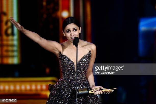 Winner of Best Performance in a Leading Role Female Bollywood actress Alia Bhatt for 'Udta Punjab' accepts her award during 18th International Indian...