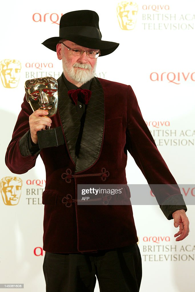 Winner of Best Single Documentary Terry Pratchett poses in front of the winners boards at the British Academy Television Awards at the Royal Festival Hall in London, on May 27, 2012.
