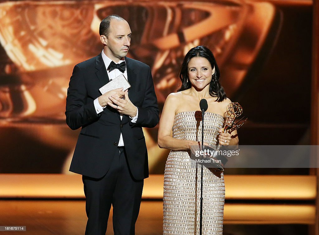 Winner of Best Supporting Actor in a Comedy Series Tony Hale and winner of Best Lead Actress in a Comedy Series, Julia Louis-Dreyfus speak onstage during the 65th Annual Primetime Emmy Awards held at Nokia Theatre L.A. Live on September 22, 2013 in Los Angeles, California.