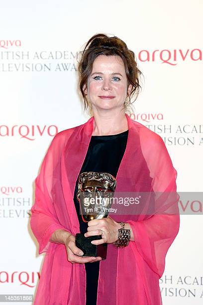 Winner of Leading Actress Emily Watson poses in front of the winners boards at The 2012 Arqiva British Academy Television Awards at the Royal...