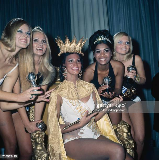 Winner of Miss World 1970 beauty pageant Jennifer Hosten of Greneda wears her crown and sits on the winnner's throne at the Royal Albert Hall in...