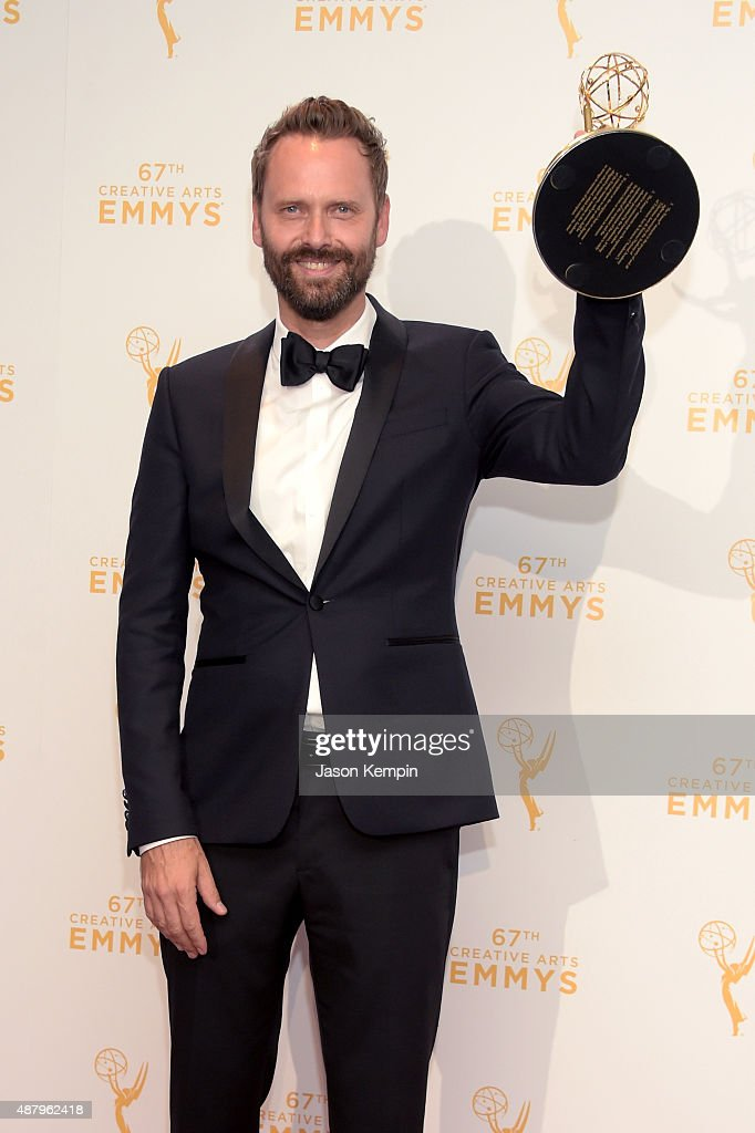 Winner of Original Main Title Theme Music Dustin O'Halloran poses in the press room during the 2015 Creative Arts Emmy Awards at Microsoft Theater on September 12, 2015 in Los Angeles, California.