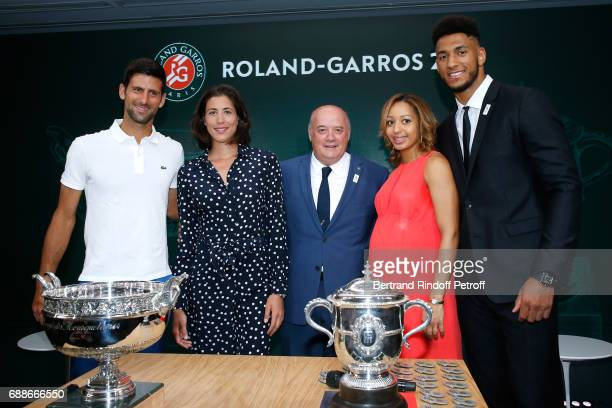 Winner of Roland Garros 2016 Novak Djokovic Spanish Winner of Roland Garros 2016 Garbine Muguruza President of French Tennis Federation Bernard...