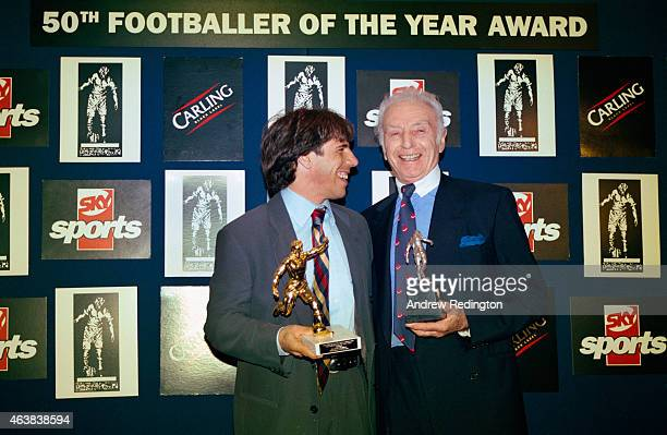Winner of the 1996/1997 Footballer of the year award Gianfranco Zola of Chelsea shares a joke with Sir Stanley Matthews winner of the 1st award in...