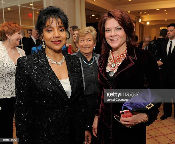 Winner of the 2012 AMEE Award in Entertainment Phylicia Rashad Broadcaster AFTRA Foundation President Shelby Scott and Winner of 2012 AMEE Award in...