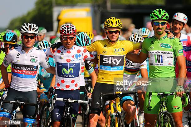 Winner of the 2013 Tour de France Chris Froome of Great Britain and SKY Procycling celebrates alongside second placed best young rider and King of...