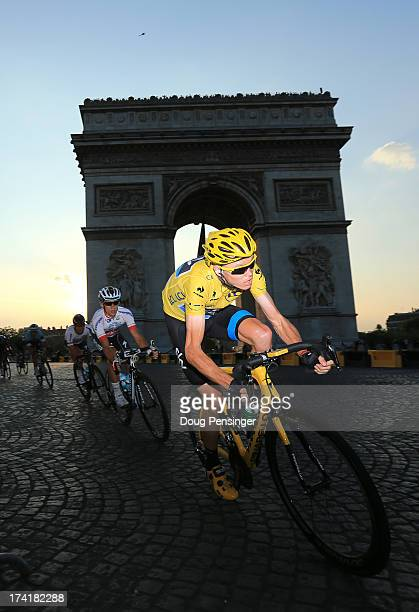 Winner of the 2013 Tour de France Chris Froome of Great Britain and SKY Procycling drives the pace from the Arc d'Triomphe during the twenty first...