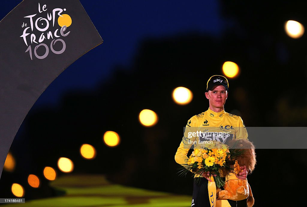 Winner of the 2013 Tour de France, <a gi-track='captionPersonalityLinkClicked' href=/galleries/search?phrase=Chris+Froome&family=editorial&specificpeople=5428054 ng-click='$event.stopPropagation()'>Chris Froome</a> of Great Britain and SKY Procycling celebrates on the podium after the twenty first and final stage of the 2013 Tour de France, a processional 133.5KM road stage ending in an evening race around the Champs-Elysees, on July 21, 2013 in Paris, France.