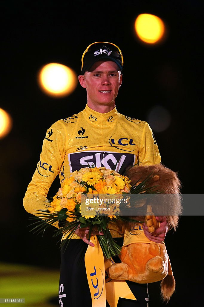 Winner of the 2013 Tour de France, Chris Froome of Great Britain and SKY Procycling celebrates on the podium after the twenty first and final stage of the 2013 Tour de France, a processional 133.5KM road stage ending in an evening race around the Champs-Elysees, on July 21, 2013 in Paris, France.