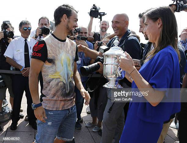 Winner of the 2015 US Open Flavia Pennetta of Italy poses with her fiance tennis player Fabio Fognini of Italy on top of Rockefeller Center midtown...