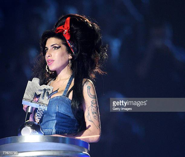 Winner of the Artist's Choice Award Amy Winehouse speaks during the show at the MTV Europe Music Awards 2007 at the Olympiahalle on November 1 2007...