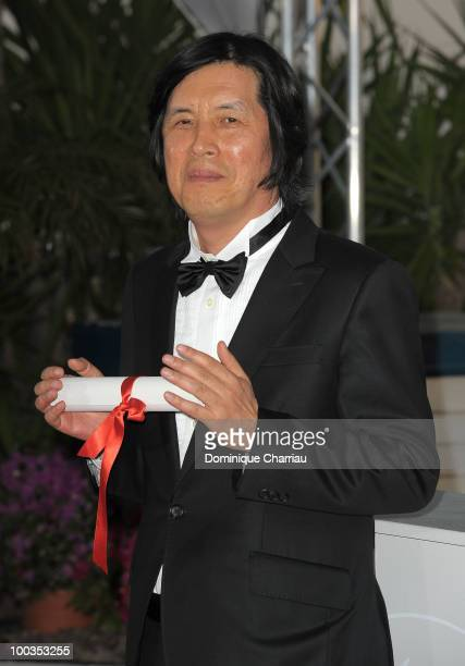 Winner of the award for Best Screenplay Director Changdong Lee attends the Palme d'Or Award Ceremony Photo Call held at the Palais des Festivals...