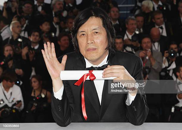 Winner of the award for Best Screenplay Director Changdong Lee attends the Palme d'Or Award Photocall held at the Palais des Festivals during the...