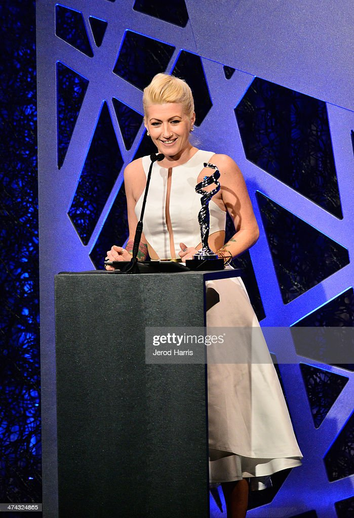 Winner of the award for Excellence in Costume Design for Fantasy Film, The Hunger Games: Catching Fire, Trish Summerville speaks onstage during the 16th Costume Designers Guild Awards with presenting sponsor Lacoste at The Beverly Hilton Hotel on February 22, 2014 in Beverly Hills, California.