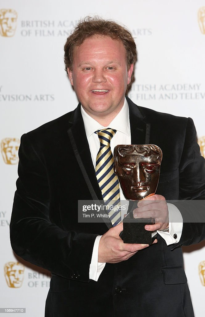 Winner of the Bafta Presnting Award Justin Fletcher poses for a photograph in the press room at the British Academy Children's Awards at London Hilton on November 25, 2012 in London, England.