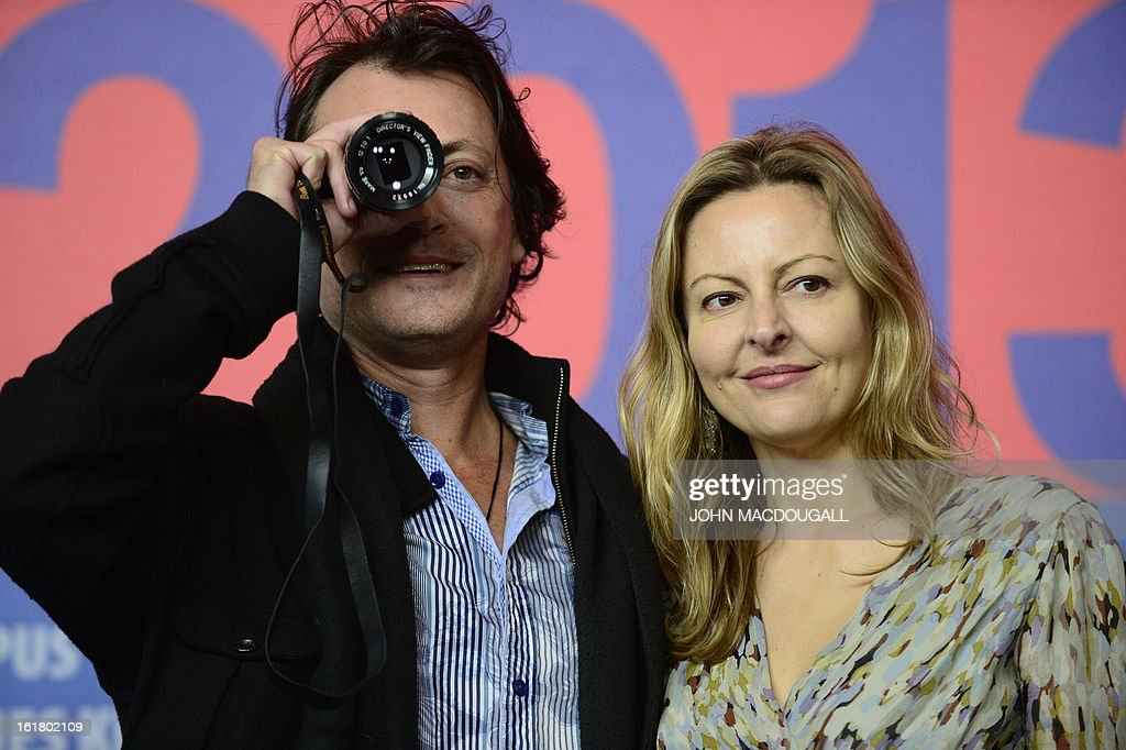 Winner of the Best First Feature Award for the movie 'The Rocket' director Kim Mordaunt (L) and producer Sylvia Wilcynski pose ahead of a press conference after the awards ceremony of the 63rd Berlinale Film Festival in Berlin on February 16, 2013. AFP PHOTO / JOHN MACDOUGALL