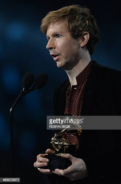 Winner of the Best Rock Album Beck talks on stage at the 57th Annual Grammy Awards in Los Angeles February 8 2015 AFP PHOTO/ROBYN BECK