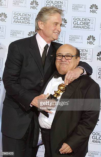 Winner of the Cecil B DeMille Award Actor Michael Douglas and Actor/Director Danny DeVito pose backstage at the 61st Annual Golden Globe Awards at...