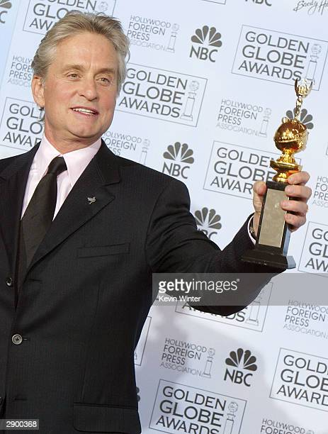 Winner of the Cecil B DeMille Award Michael Douglas poses backstage at the 61st Annual Golden Globe Awards at the Beverly Hilton Hotel on January 25...