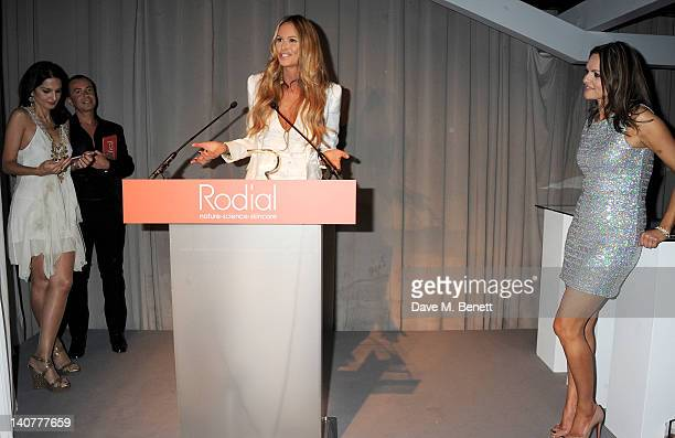 Winner of the Classic Glamour award Elle Macpherson accepts from presenters Yasmin Mills Julien Macdonald and Rodial Founder Maria Hatzistefanis as...