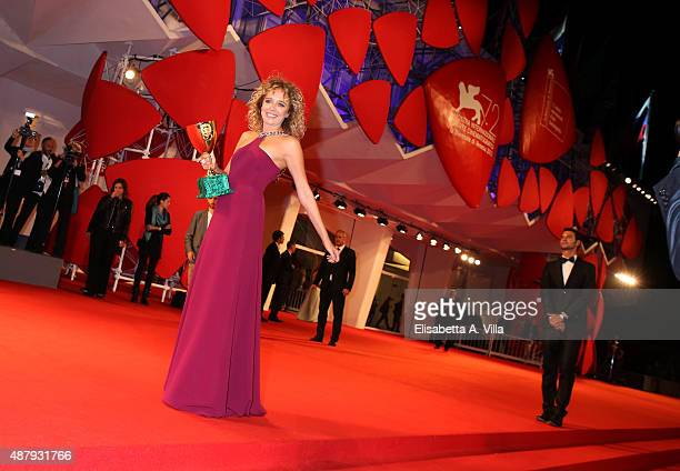 Winner of the Coppa Volpi for best Actress Award Valeria Golino shows her award on the red carpet during the 72nd Venice Film Festival on September...