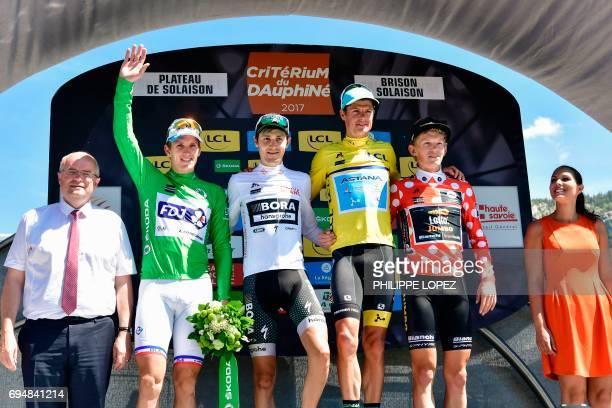Winner of the Criterium du Dauphine 2017 Denmark's Jakob Fuglsang Netherlands' Koen Bouwman wearing the best climber's polka dot jersey Germany's...