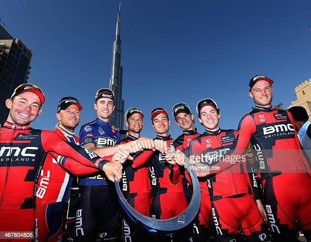 Winner of the Dubai Tour Taylor Phinney of the USA poses with the trophy along side his BMC Racing Team after stage four of the 2014 Dubai Tour on...