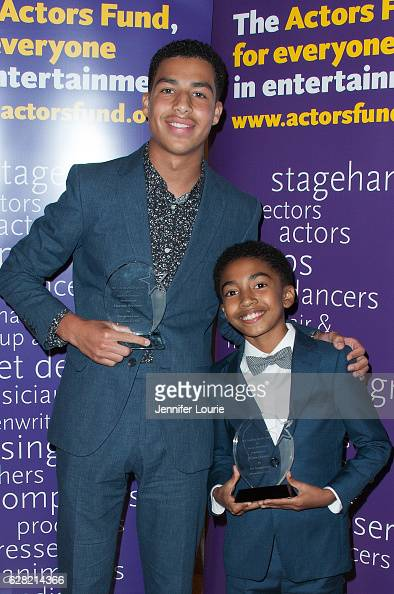Winner of the Elizabeth Taylor Award for Social Awareness Marcus Scribner and Miles Brown attend the Actors Fund's 2016 Looking Ahead Awards at the...