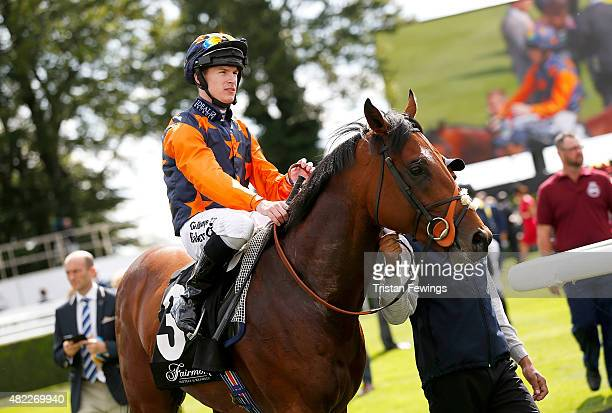 Winner of the Fairmont Molecomb Stakes Richard Kingscote on horse Kachy on day two of the Qatar Goodwood Festival at Goodwood Racecourse on July 29...
