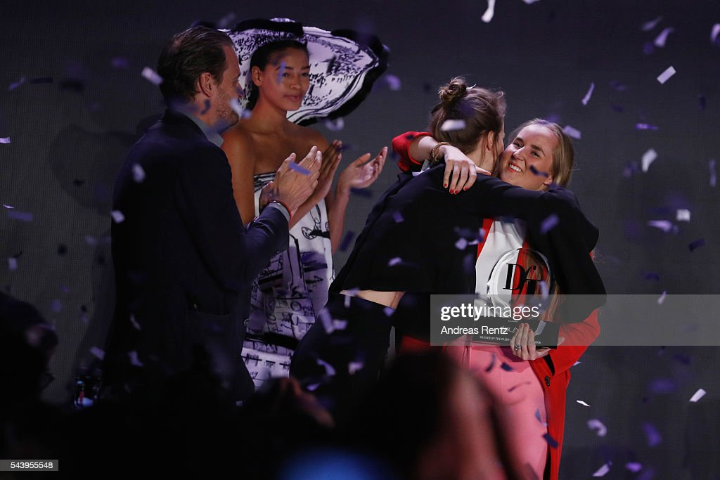 Winner of the fashion talent award 'Designer for Tomorrow' by Peek & Cloppenburg and Fashion ID hosted by Alber Elbaz, Edda Gimnes (R) is congratulated by last years winner designer Mareike Massing during the Mercedes-Benz Fashion Week Berlin Spring/Summer 2017 at Erika Hess Eisstadion on June 30, 2016 in Berlin, Germany.